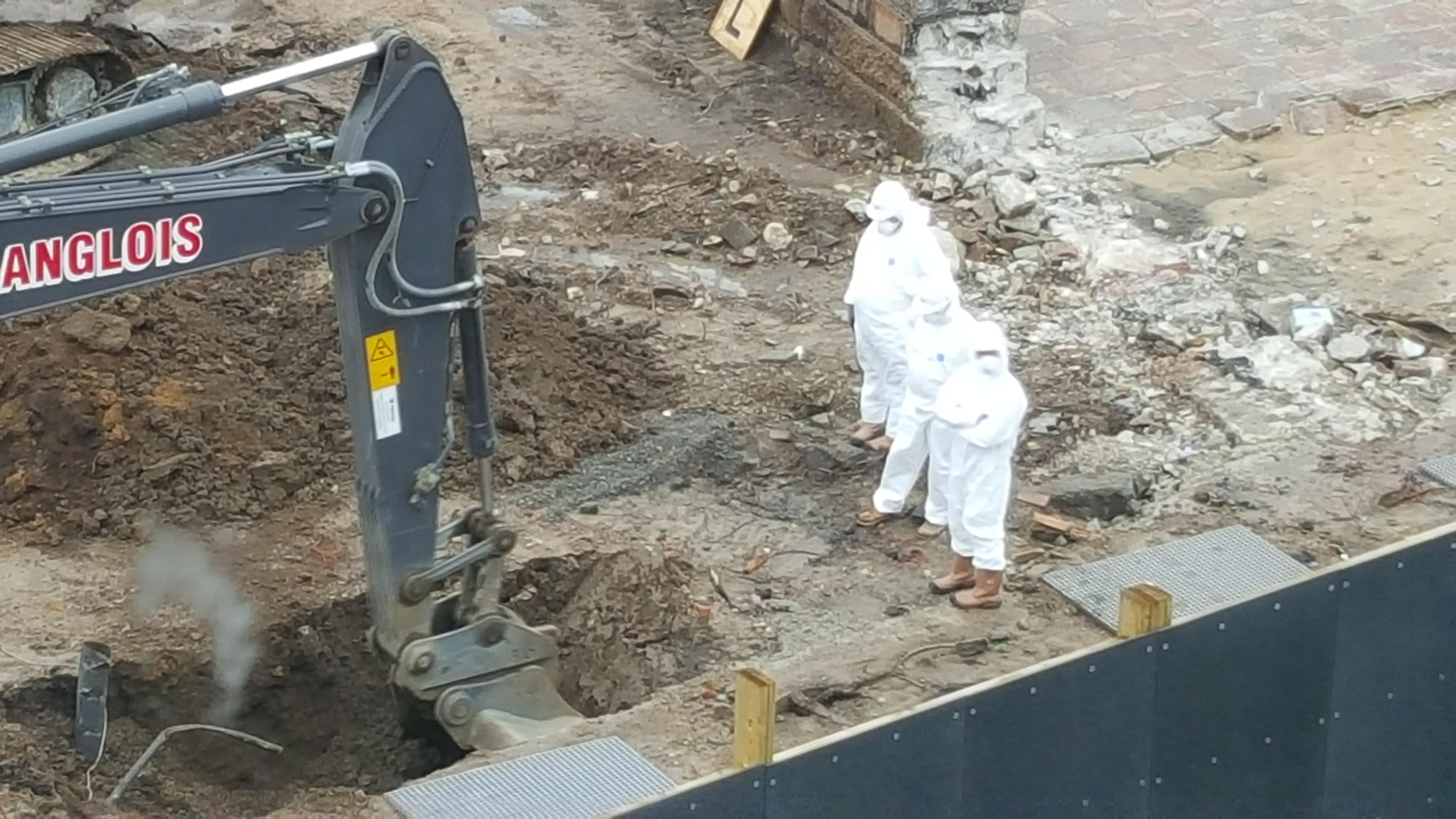 asbestos in dust - men in hazmat suits - sos jersey